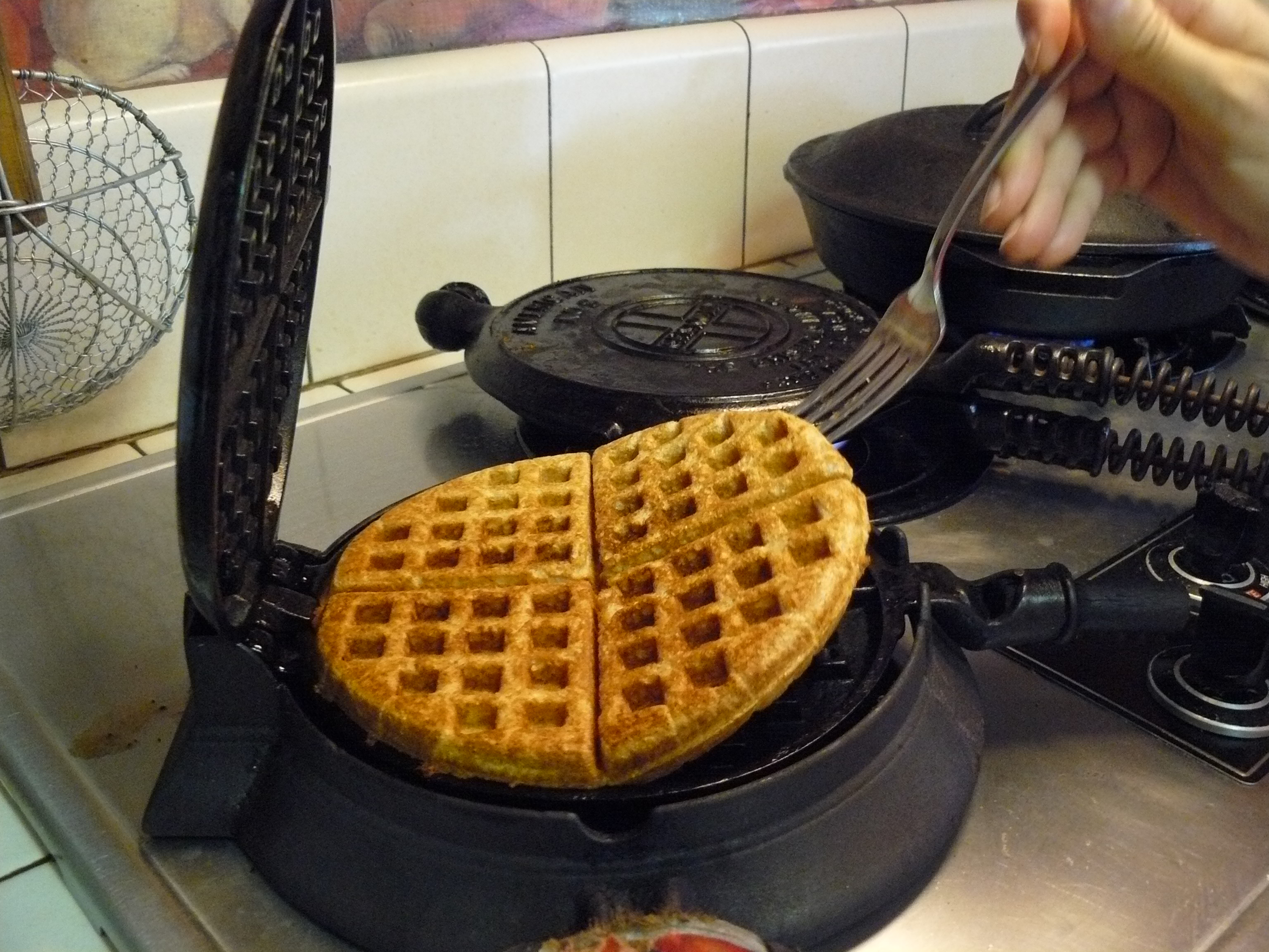 Lifting waffle from our 1880 waffle maker